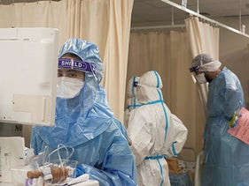 Medical professionals in protective equipment work in the coronavirus ward at Shaare Zedek Medical Center in Jerusalem, last month.