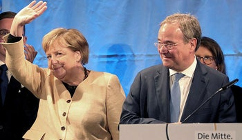 Armin Laschet, chairman of the German Christian Democratic Union (CDU) and the party's top candidate for the federal election, right, and German chancellor Angela Merkel attend a joint campaign appearance in Stralsund, Germany