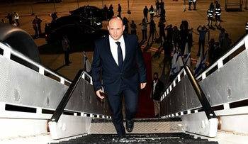 Israeli Prime Minister Naftali Bennett embarks on his plane as he sets to leave Israel overnight into Sunday.