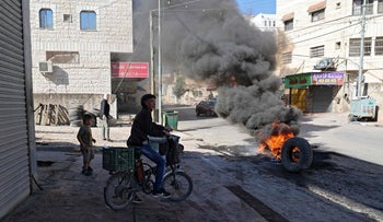 Palestinians burning tires in West Bank city of Burkin, yesterday.