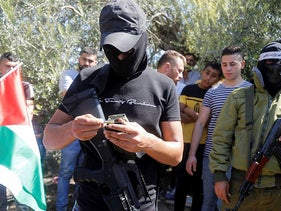 Militants attend the funeral of Palestinian Osama Soboh who was killed by Israeli forces during clashes in a raid, in Burkin, West Bank, today.