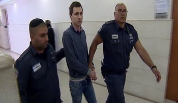 Aleksey Burkov, being detained by Israeli police officers.