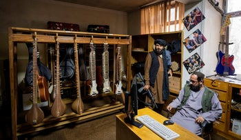 Fighters from the Haqqani network appear inside a room of the Afghanistan National Institute of Music in Kabul, earlier this month.