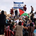 Palestinians from the West Bank village of Susya confront Jewish settlers from the settlement of the same name, during the visit of an EU delegation, on Friday.