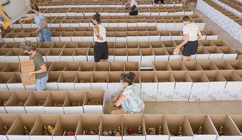 Volunteers preparing food donation boxes for families in need ahead of the High Holy Days