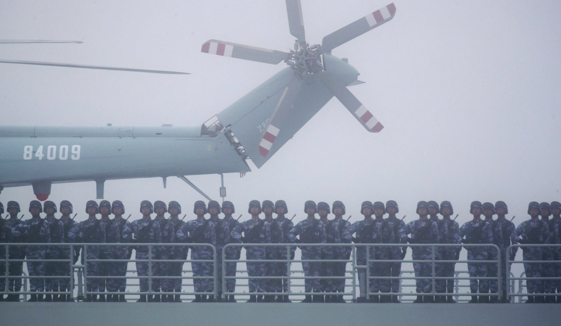 Chinese soldiers aboard a ship participating in a ceremony in 2019.