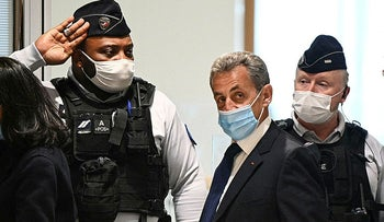 Former French President Nicolas Sarkozy arrives at the Paris courthouse, in March.