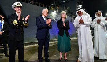 Foreign Minister Lapid poses with Bahrain's Abdullatif bin Rashid Al Zayani, U.S. Vice Admiral Brad Cooper, U.S. chargé d'affaires Maggie Nardi and others, in Bahrain, on Thursday.