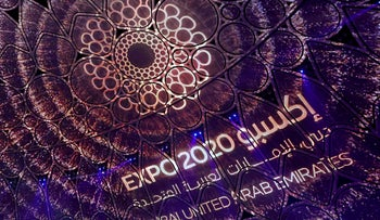 A logo of the Dubai Expo 2020 is projected during the opening ceremony, on Thursday.