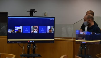 The Palestinian prisoners appear in court via video chat, on Sunday.