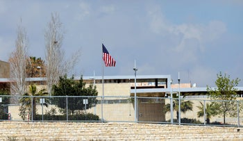 A United States flag flies over a complex belonging to the U.S. Consulate in Jerusalem.