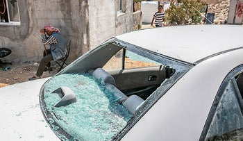 Car damaged by Jewish settlers in the West Bank