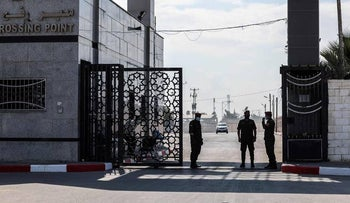 Palestinian officials at the Rafah border crossing between the Gaza Strip and Egypt, Oct. 2, 2021