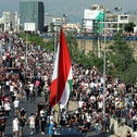 People carry flags and banners as they march to mark the one-year anniversary of Beirut's port blast, in Beirut Lebanon, last month.