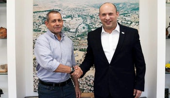 Outgoing Shin Bet head Nadav Argaman (L) and PM Naftali Bennett at the Shin Bet headquarters in July.