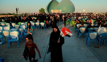 """Followers of a political movement called """"Al-Fateh Alliance"""" chant during a rally before the parliamentary elections in Baghdad, Iraq, yesterday."""