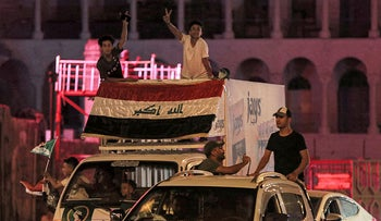 Supporters of Iraqi Shiite cleric Muqtada al-Sadr ride in vehicles after the close of polls during the early parliamentary elections, yesterday