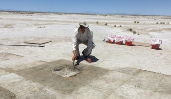 An archaeologist digging the hearth at the prehistoric Wishbone site in Utah's Great Salt Lake Desert.