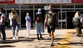Students wearing face masks at the University of Haifa on the first day of the academic year, on Sunday.