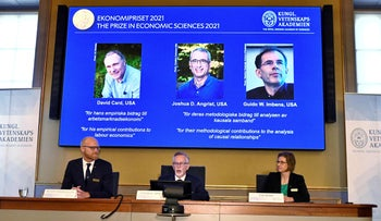 Nobel Economics Prize committee members announce the winners of the 2021 prize, in Stockholm, on Monday.