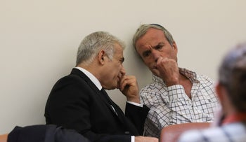 Yair Lapid, left, and Elazar Stern at a meeting of legislators from their Yesh Atid party in April.