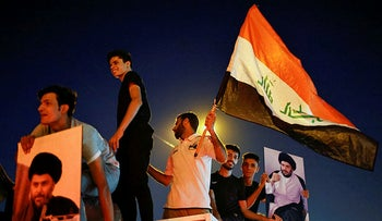 Supporters of Moqtada al-Sadr celebrating the results of the Iraqi election, on Monday