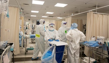 Medical professionals in protective equipment work in the coronavirus ward at the Shaare Zedek Medical Center in Jerusalem, August.