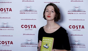 Sally Rooney poses for a photograph ahead of the announcement of the winner of the Costa Book Awards in London, 2019.