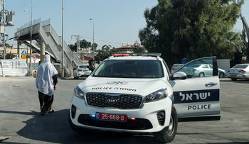 A police car at the scene of a murder in Lod, June.
