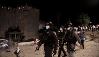 Israeli police clear protesters from the plaza in front of the Damascus Gate to Jerusalem's Old City, last month.