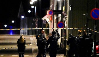 Police officers investigate after several people were killed and others were injured by a man using a bow and arrows to carry out attacks, in Kongsberg, Norway, today.