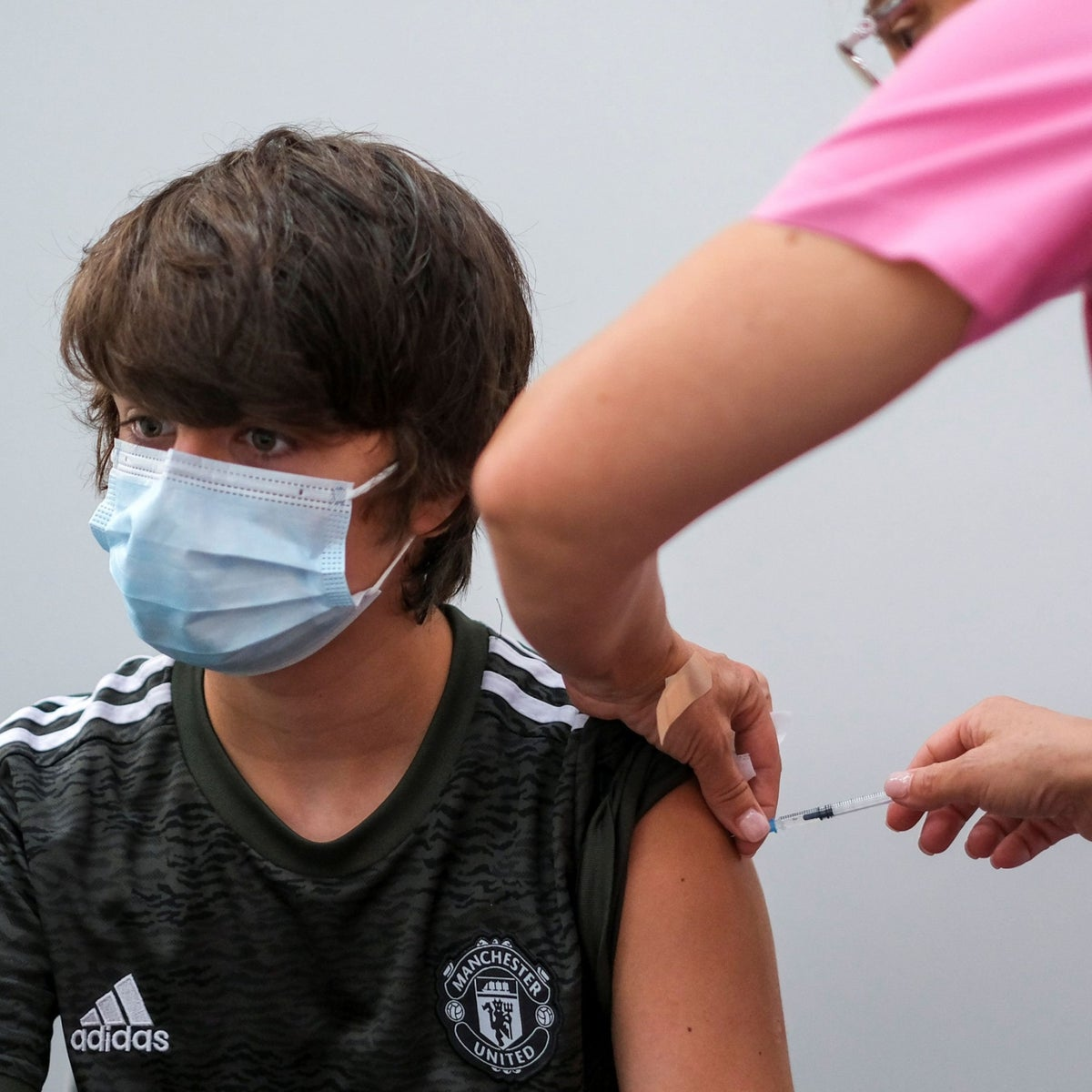 A boy in Portugal receiving his second dose of the Pfizer vaccine, last month.