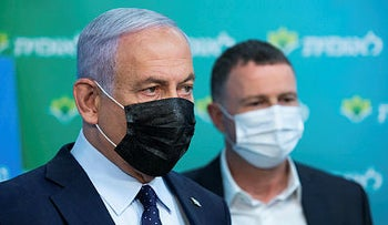 Then-Prime Minister Benjamin Netanyahu and then-Health Minister Yuli Edelstein visit an HMO clinic, February.