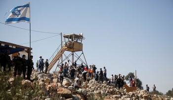 Demonstrators take part in a protest in support of Palestinian farmers and against Israeli settlements, in Beita, in the West Bank, last week.