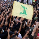 Supporters of Lebanon's Hezbollah attend a funeral of people who were killed in violence in Beirut on Thursday, in Beirut's southern suburbs, Lebanon, yesterday.