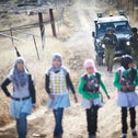 Children from the village of Tuba in the South Hebron Hills walking to school. For 16 years, the IDF has escorted them because of the threat of settler violence