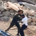 A video still showing deputy battalion commander Moshe Maor pushing a Palestinian in the South Hebron Hills, last month.