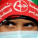 A girl wearing a protective face mask and the headband of the Popular Front for the Liberation of Palestine in Gaza City, last year.