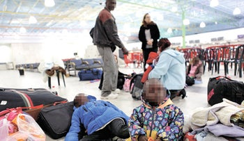 Darfurian refugees at Ben-Gurion Airport before taking off for Sudan in 2011. Israeli officials claimed they left voluntarily despite the risks, but threats and financial inducements are systematic.