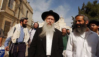 A photo of Rabbi Yitzhak Ginsburg with his followers.