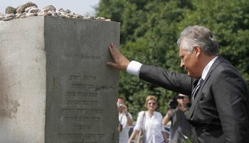 Former Polish President Alekdander Kwasniewski attends a memorial to the Jedwabne massacre in July 2011.