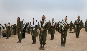 Ceremony marking the end of basic training of a Nahal Haredi battalion.