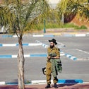 A soldier in the Netzah Yehuda ultra-Orthodox battalion standing in a parking lot, April 25, 2012.