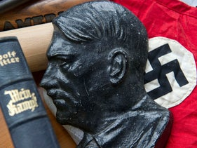 A Hitler bust and other items confiscated in a crackdown on a neo-Nazi group in Western Germany, March 2012.