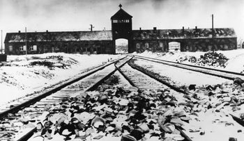 1941 photo showing the railroad tracks leading to the entrance of the concentration camp Auschwitz-Birkenau.