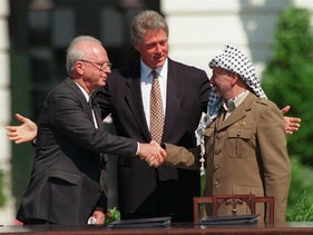 Yitzhak Rabin, Bill Clinton and Yasser Arafat at the ceremony marking the signing of the Oslo peace accord on the White House lawn, September 13, 1993.
