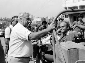 Ariel Sharon, then defense minister, with troops in Lebanon in early 1980s.
