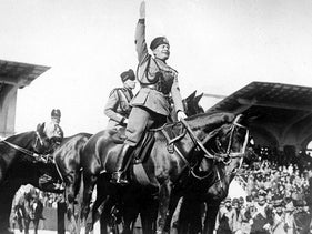 Italian dictator and Prime Minister Benito Mussolini on horseback salutes a review of fascists, Italy, October 1927.