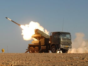 A David's Sling/Magic Wand missile is launched from a truck-mounted launcher, part of the missile defense system developed in partnership with Israel Military Industries.