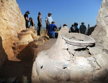 Monumental construction and giant jars, containing scorched wheat, found at Hazor, July 23, 2012